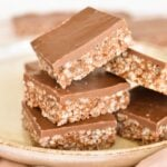 squares of mars bar slice stacked on plate