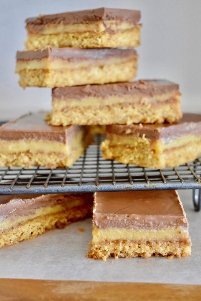 caramel slice stacked on a cooling tray
