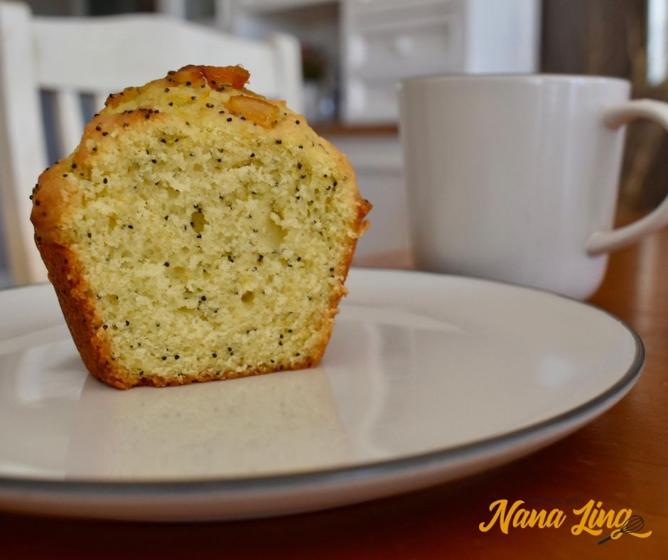 sliced piece of orange and poppy seed muffin