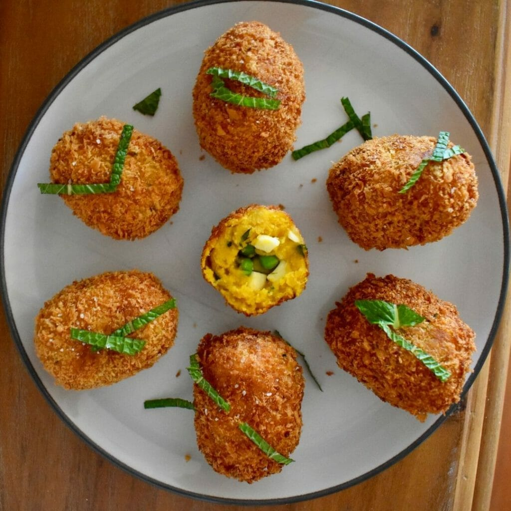 pumpkin croquettes displayed in a round pattern on a plate