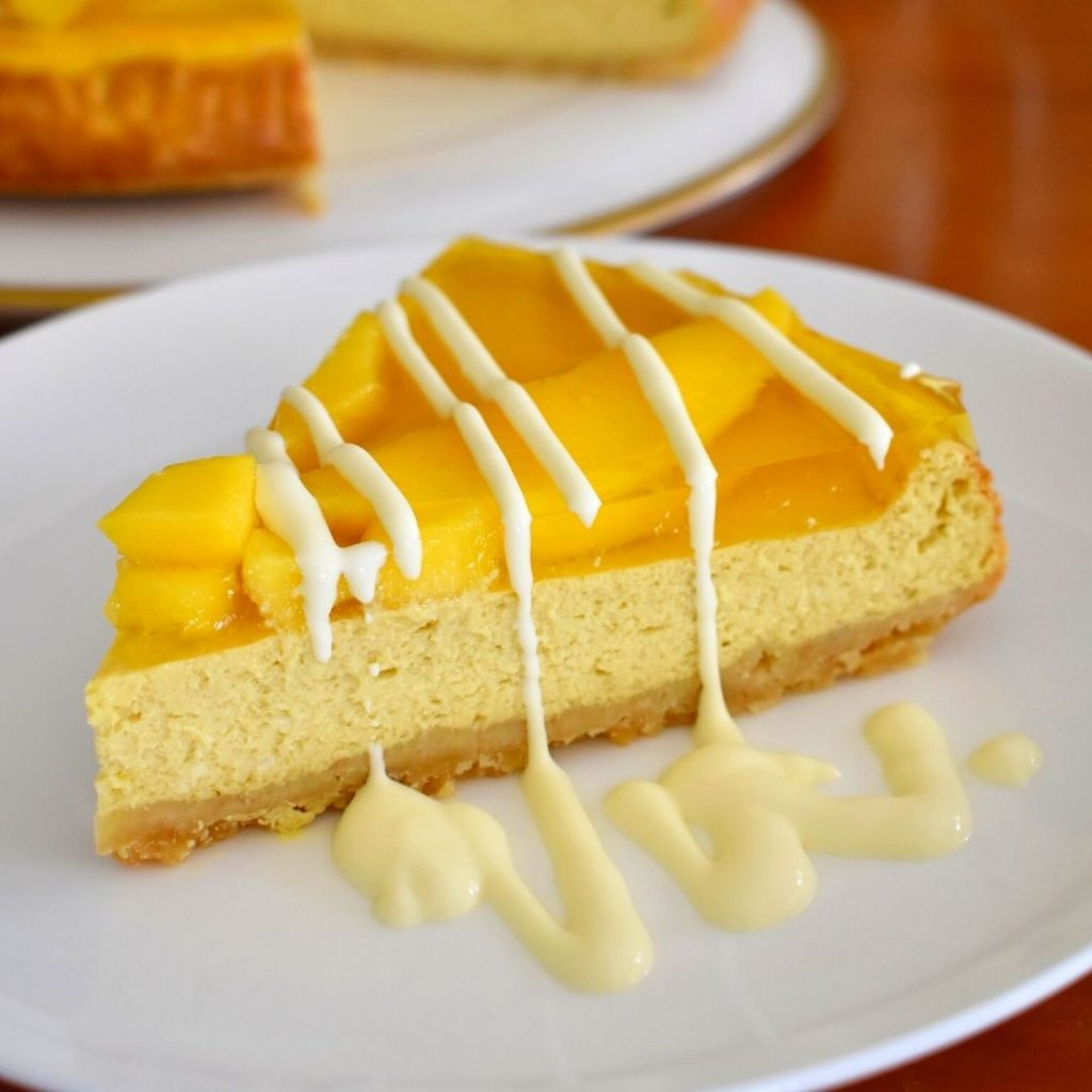 close up picture of slice of mango cheesecake