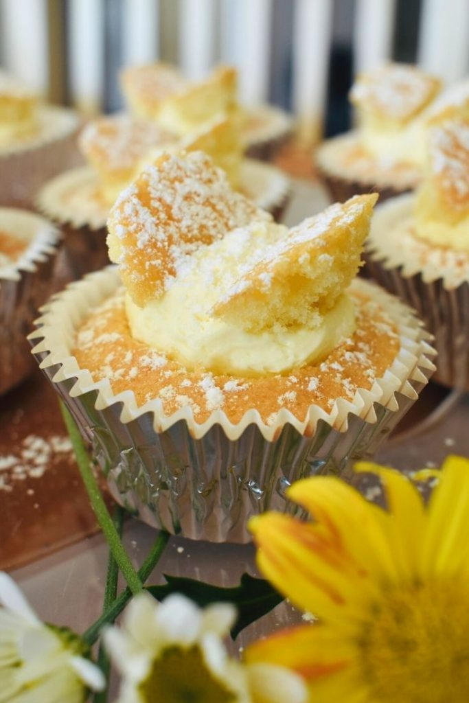butterfly cupcakes on table with flowers