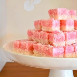 coconut ice coloured white and pink stacked on cake plate