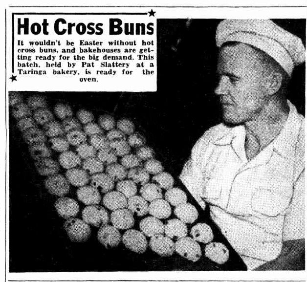 baker with tray of hot cross buns