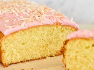 coconut cake with pink icing and lightly toasted coconut