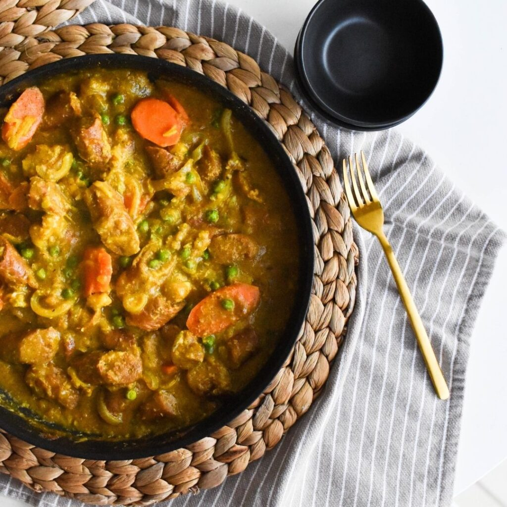 curried sausages in frypan