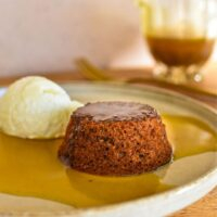 sticky date pudding on plate with sauce